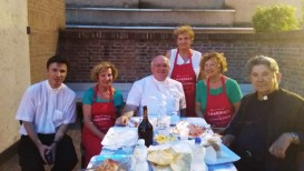 Mons. Perego, don Giacomo Granzotto, Mons. Antonio Bentivoglio e alcune volontarie